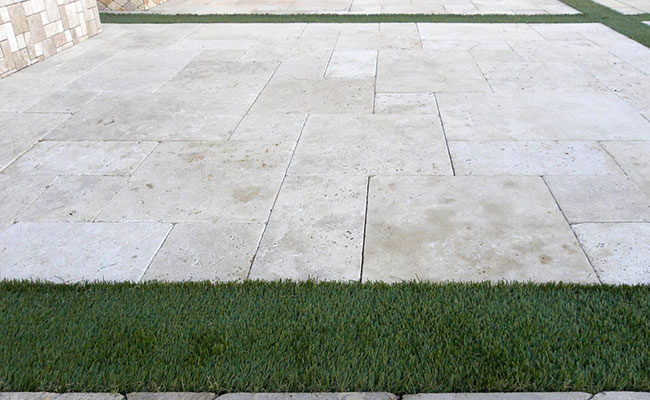 Travertine Paverstone Patio with Artificial Grass