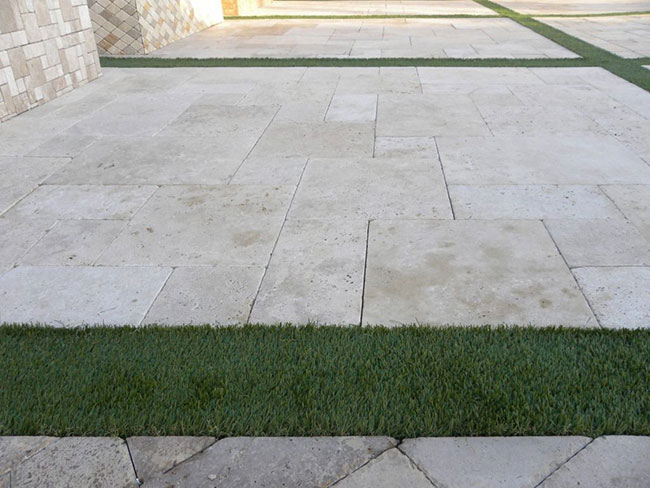 Travertine Paverstone Patio with Artificial Grass in Dana Point, CA